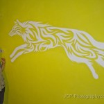 Wall painting of a tribal wolf with my mom next to it.